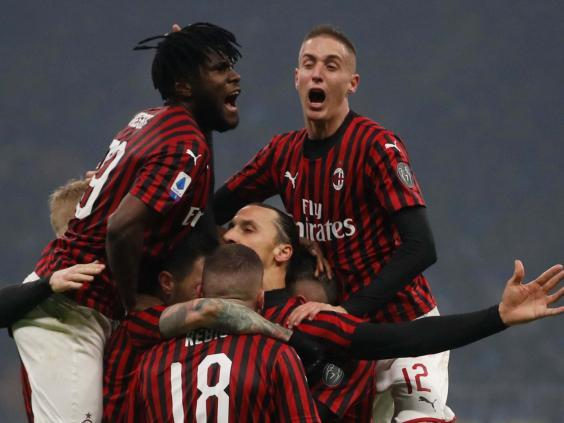 Ibrahimovic is mobbed after scoring in the Milan derby (AP)