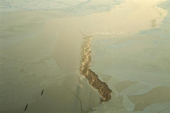 Steam rises from seawater through a crack in the Arctic ice near the 2011 Applied Physics Laboratory Ice Station north of Prudhoe Bay, Alaska March 18, 2011.