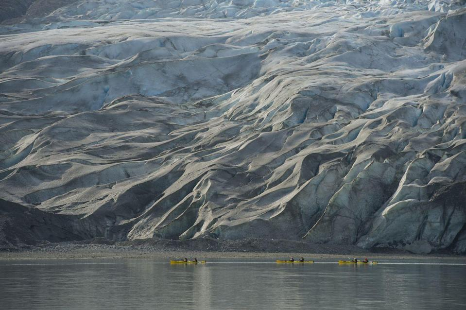 <p>The people kayaking in front of the Reid Glacier in Glacier Bay National Park, Alaska, really illustrate the true scale of the ice caps // January 1, 2012</p>