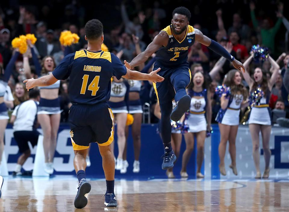 <p>Evan Leonard #14 of the UC Irvine Anteaters celebrates a three-point shot with Max Hazzard #2 in the second half against the Kansas State Wildcats during the first round of the 2019 NCAA Men's Basketball Tournament at SAP Center on March 22, 2019 in San Jose, California. (Photo by Yong Teck Lim/Getty Images) </p>
