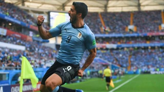 Uruguay book their place in the World Cup knockout stage along with Russia, as Luis Suarez scores during his 100th international appearance in a 1-0 victory over Saudi Arabia.
