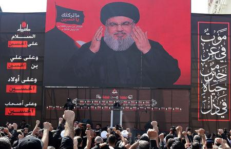 Lebanon's Hezbollah leader Sayyed Hassan Nasrallah gestures as he addresses his supporters via a screen during last day of Ashura, in Beirut, Lebanon September 20, 2018. REUTERS/Aziz Taher