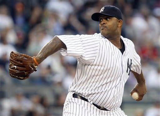New York Yankees' pitcher CC Sabathia delivers during the first inning of a baseball game against the Tampa Bay Rays, Thursday, June 7, 2012, at Yankee Stadium in New York. (AP Photo/Seth Wenig)