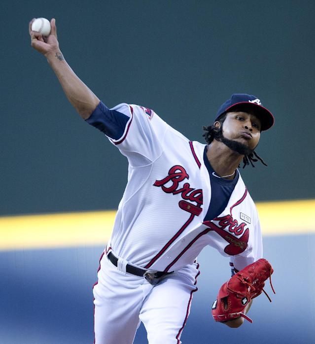 Atlanta Braves starting pitcher Ervin Santana (30) works in the first inning of a baseball game against the Los Angeles Dodgers Wednesday, Aug. 13, 2014, in Atlanta. (AP Photo/John Bazemore)