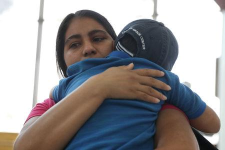 "FILE PHOTO: Dunia, an asylum seeker from Honduras, is reunited with her five-year-old son Wilman at Brownsville South Padre International Airport in Brownsville, Texas, U.S., following their separation of more than five weeks through the Trump administration's ""Zero Tolerance"" policy, July 20, 2018.  REUTERS/Loren Elliott/File Photo"