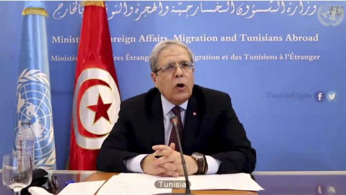 In this image made from UNTV video, Tunisia's Foreign Minister Othman Jerandi speaks during a U.N. Security Council high-level meeting on COVID-19 recovery focusing on vaccinations, chaired by British Foreign Secretary Dominc Raab, Wednesday, Feb. 17, 2021, at UN headquarters, in New York. (UNTV via AP)