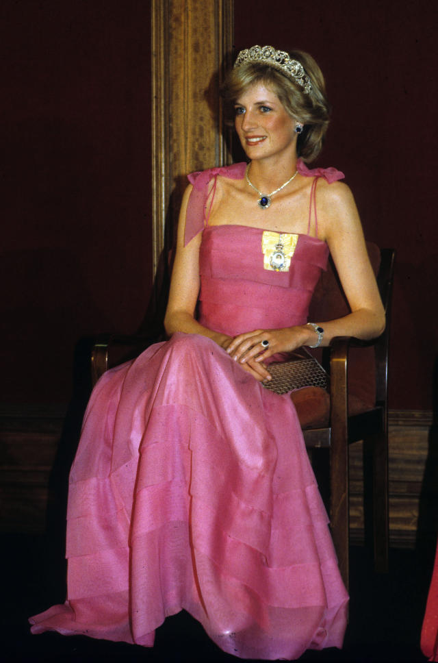<p>Princess Diana was given a sapphire jewelry set from the Crown Prince Fahd of Saudi Arabia as a wedding gift. The Princess of Wales demonstrated her sartorial flair by having the watch and ring transformed into a choker, which she sometimes wore as a headpiece. (Photo: PA) </p>