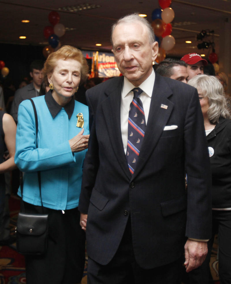 FILE - In this May 18, 2010 file photo, Sen. Arlen Specter, D-Pa., and his wife Joan Specter, leave the election party after Specter gave his concession speech to supporters in Philadelphia. Specter lost to Rep. Joe Sestak, D-Pa., for the Democratic Senate nomination. As Specter leaves the Senate after 30 years of roll calls, debates, dealmaking and votes, he says he wouldn't change a thing about his political path. (AP Photo/Carolyn Kaster, File)