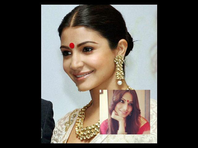 """<div class=""""heading03"""">Red Bindi</div> <p><span style=""""text-decoration: underline;""""><strong>Celeb Example: </strong><strong>Anushka Sharma</strong></span></p> Our <em>Bijli </em>from <em>Matru ki Bijli ka Mandola </em>and YRF camp's favourite, Anushka looks stunning in this red <em>bindi, </em>she wears with the this off-white suit. The chunky neckpiece and earrings complement her neatly tied bun. We give full marks to this beautiful lady who does keep hearts racing with her sensational style and acting skills."""