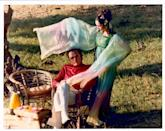 <p>After divorcing in 1974, Richard Burton and Elizabeth Taylor re-wed in a small intimate ceremony. The bride wore a rainbow peasant gown with flowers in her hair, while Richard opted for a very '70s look: a red turtleneck and white slacks.<br></p>