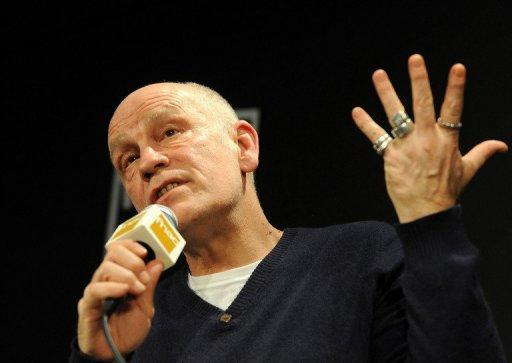 """I don't care if I get paid at all,"" Malkovich told a news conference"