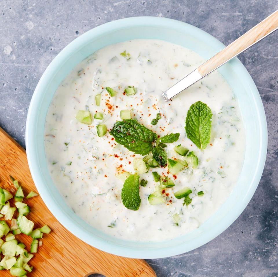 """<p>This simple cucumber raita can be adjusted to your personal preferences, so feel free to swap in your favourite herb, citrus juice, or alternate spices. Sugar can be added if you're finding your raita too sour, and if taming heat is none of your concern, throw in some chopped chillies! </p><p>Get the <a href=""""https://www.delish.com/uk/cooking/recipes/a35064691/raita-recipe/"""" rel=""""nofollow noopener"""" target=""""_blank"""" data-ylk=""""slk:Cucumber Raita"""" class=""""link rapid-noclick-resp"""">Cucumber Raita</a> recipe.</p>"""