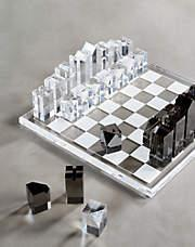 """<h2>Acrylic Chess Set</h2><br>If you and your mom binge-watched """"The Queen's Gambit"""" like the rest of us, this is the purchase for you. <br><br><strong>CB2</strong> Acrylic Chess Set, $, available at <a href=""""https://go.skimresources.com/?id=30283X879131&url=https%3A%2F%2Fwww.cb2.com%2Facrylic-chess-set%2Fs129649"""" rel=""""nofollow noopener"""" target=""""_blank"""" data-ylk=""""slk:CB2"""" class=""""link rapid-noclick-resp"""">CB2</a>"""