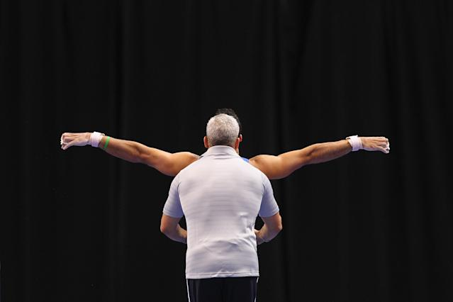 ST. LOUIS, MO - JUNE 7: Danell Levya warms up with his coach prior to competing the high bar during the Senior Men's competition on day one of the Visa Championships at Chaifetz Arena on June 7, 2012 in St. Louis, Missouri. (Photo by Dilip Vishwanat/Getty Images)