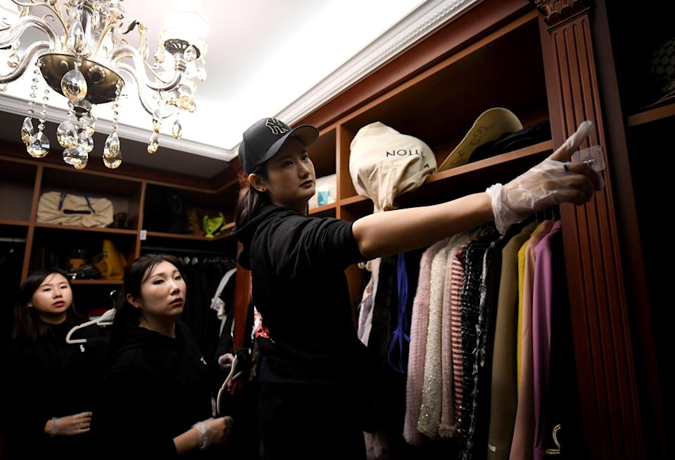 Home organisers arranging the luxury wardrobe of client Chen Rui in Beijing