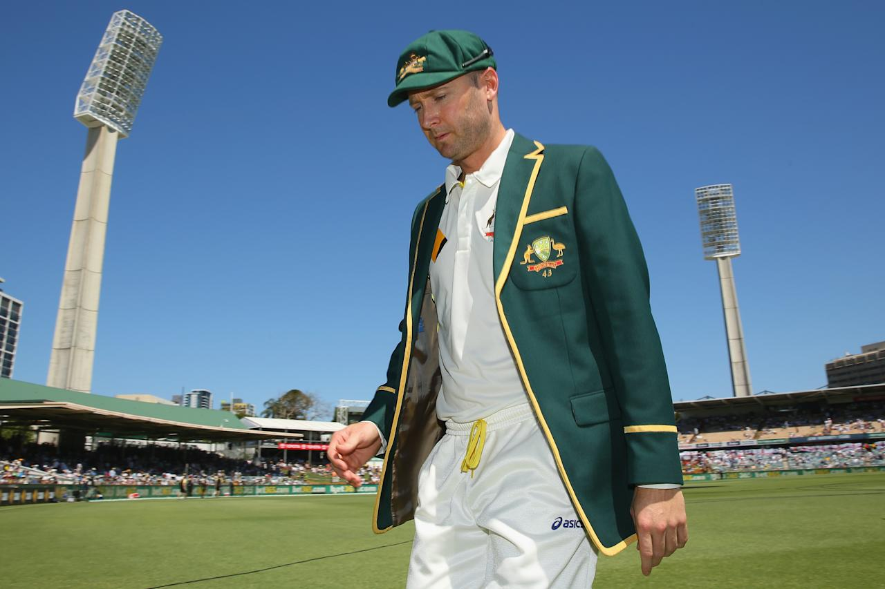 PERTH, AUSTRALIA - DECEMBER 13:  Michael Clarke of Australia leaves the field after the toss during day one of the Third Ashes Test Match between Australia and England at WACA on December 13, 2013 in Perth, Australia.  (Photo by Mark Kolbe/Getty Images)