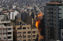 An Israeli airstrike hits the high-rise building housing The Associated Press' offices in Gaza City, Saturday, May 15, 2021. The airstrike Saturday came roughly an hour after the Israeli military ordered people to evacuate the building. The building housed The Associated Press, Al-Jazeera and a number of offices and apartment. (AP Photo/Hatem Moussa)