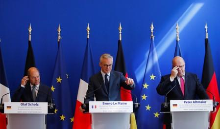 French Finance Minister Bruno Le Maire, German Economy Minister Peter Altmaier and German Finance Minister Olaf Scholz attend a joint news conference after a meeting in Paris