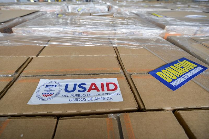 US aid has become a focus of the conflict between President Nicolas Maduro and opposition leader Juan Guaido (AFP Photo/LUIS ROBAYO)