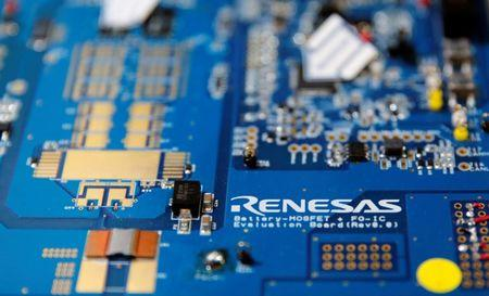 Renesas Electronics Corp's logo is seen on its substrate at the company's conference in Tokyo