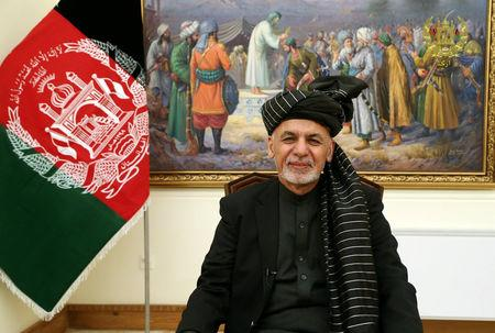 Afghanistan's President Ashraf Ghani speaks during a live TV broadcast at the presidential palace in Kabul