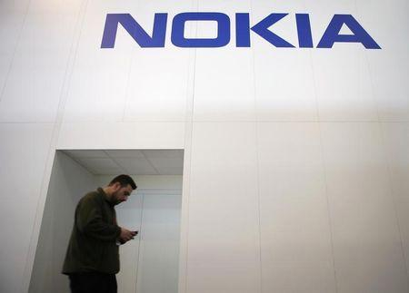 A man walks past the Nokia stand while attending the Mobile World Congress in Barcelona