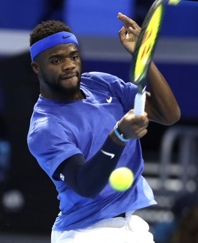 Frances Tiafoe, of the United States, returns the ball to Alex De Minaur, of Australia, during the ATP Next Gen tennis tournament semifinal match, in Milan, Italy, Friday, Nov. 8, 2019. (AP Photo/Luca Bruno)