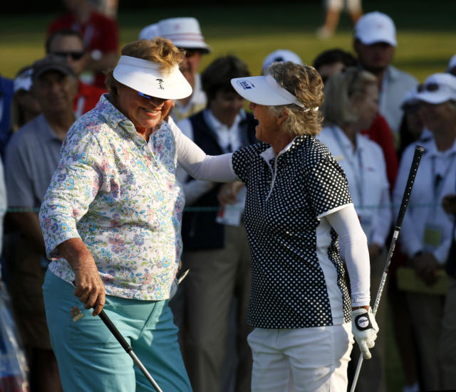 JoAnne Carner, left, laughs with Sandra Palmer on the first tee during the first round of the inaugural U.S. Senior Women's Open golf tournament in Wheaton, Ill., Thursday, July 12, 2018. (Daniel White/Daily Herald via AP)