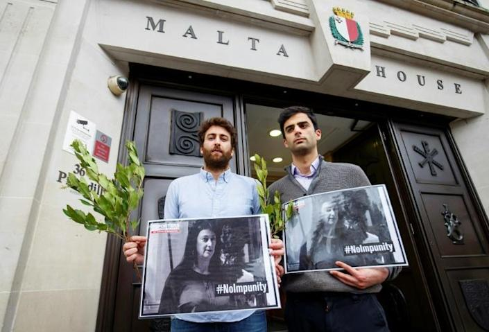 Caruana Galizia's sons Matthew and Paul at a vigil in London hoping for justice for their journalist mother (AFP Photo/Tolga AKMEN)