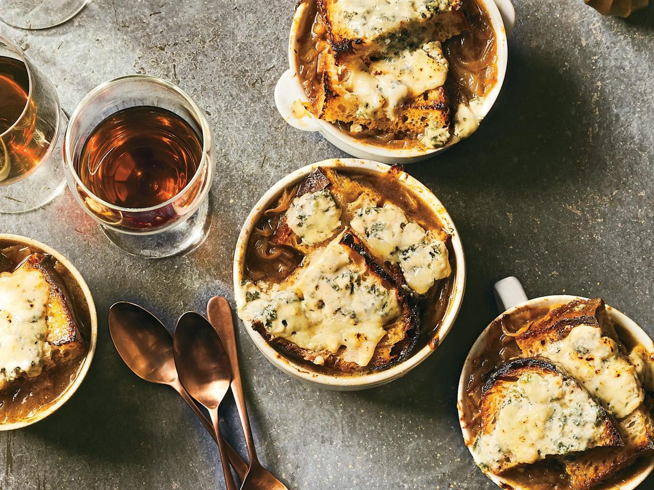 """<p>In this vegetarian version of classic French onion soup, blue cheese and oloroso sherry bring new layers of flavor and depth. Notes of toasted nuts and fruit compote in the sherry pair well with caramelized onions, and its briny acidity cuts through the richness of the cheese.</p> <p> <a href=""""https://www.foodandwine.com/recipes/caramelized-onion-and-bread-soupwith-bruleed-blue-cheese"""">Go to Reicpe</a></p>"""