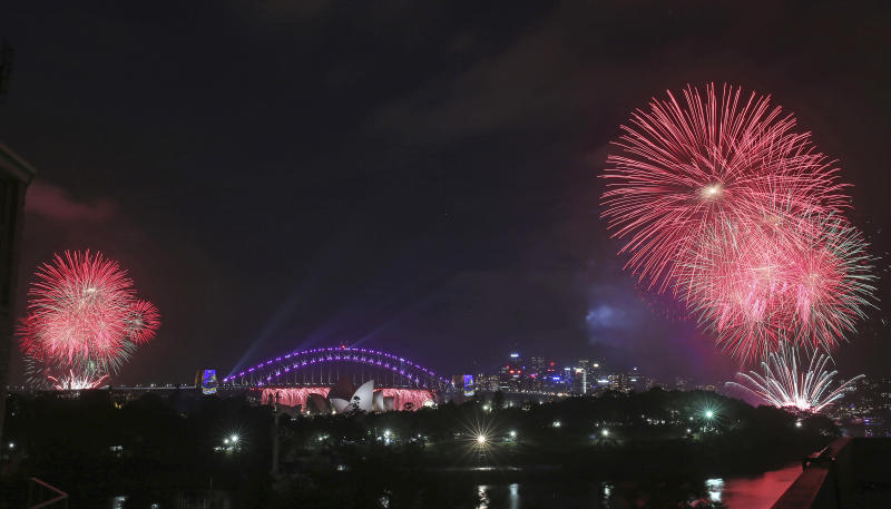 <p> Fireworks explode around the Sydney Opera House and Harbour Bridge as New Year's celebrations get underway in Sydney, Australia, Saturday, Dec. 31, 2016. (AP Photo/Rick Rycroft) </p>