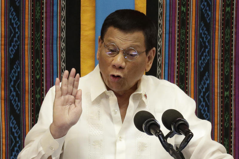 FILE - In this July 22, 2019, file photo, Philippine President Rodrigo Duterte speaks during his 4th State of the Nation Address at the 18th Congress at the House of Representatives in Quezon city, Philippines. Duterte decided to end martial law in the southern Philippines after more than two years after government forces weakened Islamic militant groups considerably with the capture and killing of their leaders, his spokesman said Tuesday, Dec. 10, 2019. (AP Photo/Aaron Favila, File)