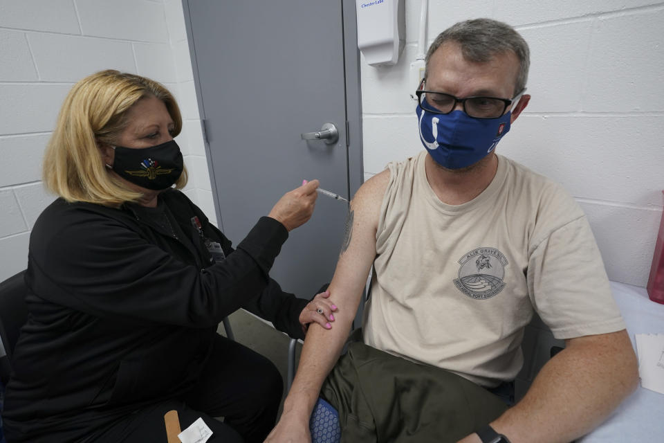 Veronica Pfister, R.N., administers a Johnson and Johnson Covid-19 vaccine to race fan Joshua Knight, of Noblesville, Ind., at the Indianapolis Motor Speedway before the Indianapolis 500 auto race in Indianapolis, Sunday, May 30, 2021. (AP Photo/Paul Sancya)