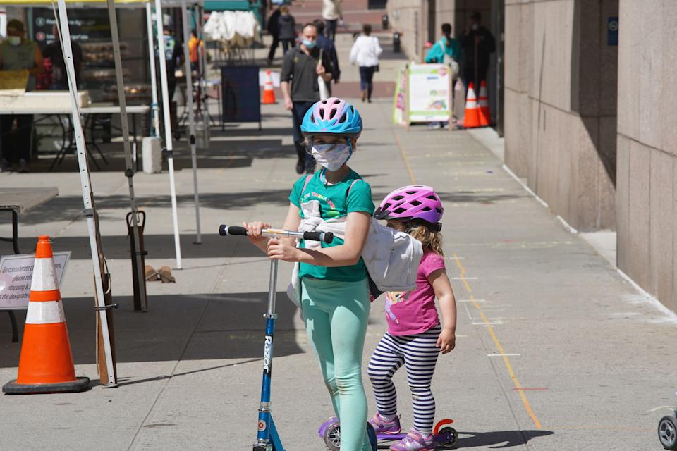 NEW YORK, NEW YORK - MAY 21:  Children wearing protective face mask wait to cross a street on May 21, 2020 in New York City. COVID-19 has spread to most countries around the world, claiming over 332,000 lives with infections of over 5.1 million people. (Photo by Rob Kim/Getty Images)