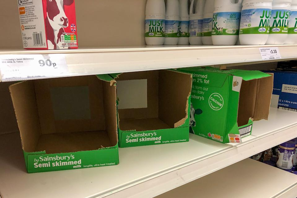 A shortage of UHT long life milk on the shelves at a Sainsbury's supermarket in Cambridge