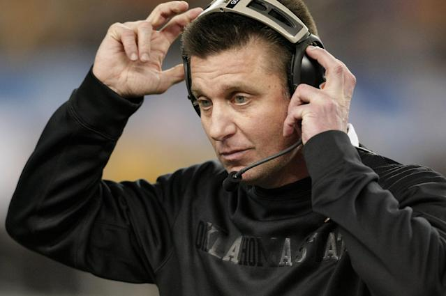 Oklahoma State head coach Mike Gundy adjusts his headset during the second half of the Cotton Bowl NCAA college football game against Missouri, Saturday, Jan. 4, 2014, in Arlington, Texas. Missouri won 41-31. (AP Photo/Brandon Wade)
