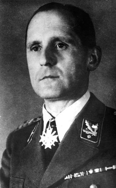 """FILE - Undated b/w file picture of former German Gestapo head Heinrich Mueller. For decades there were alleged sightings of Mueller in Cuba, Argentina and elsewhere. But Johannes Tuchel, director of Berlin's German Resistance Memorial Center, said Thursday Oct. 31, 2013 he's uncovered evidence Mueller didn't make it out of Berlin. He says several documents, including a 1945 death certificate and a grave digger's testimony to police in 1963, make it """"clear-cut"""" to him that Mueller died and was buried near the Luftwaffe headquarters in the final days of the war. He says Mueller was later disinterred and buried with thousands others in a common grave in a Jewish cemetery destroyed by the Nazis. (AP-Photo,File)"""