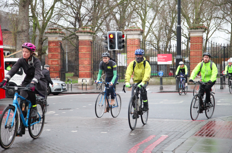 Cycling to work can lower the risk of developing cancer and heart disease (Rex)