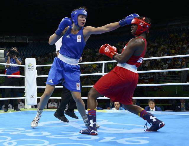 2016 Rio Olympics - Boxing - Final - Women's Middle (75kg) Final Bout 270 - Riocentro - Pavilion 6 - Rio de Janeiro, Brazil - 21/08/2016. Claressa Shields (USA) of USA and Nouchka Fontijn (NED) of Netherlands compete. REUTERS/Peter Cziborra FOR EDITORIAL USE ONLY. NOT FOR SALE FOR MARKETING OR ADVERTISING CAMPAIGNS.