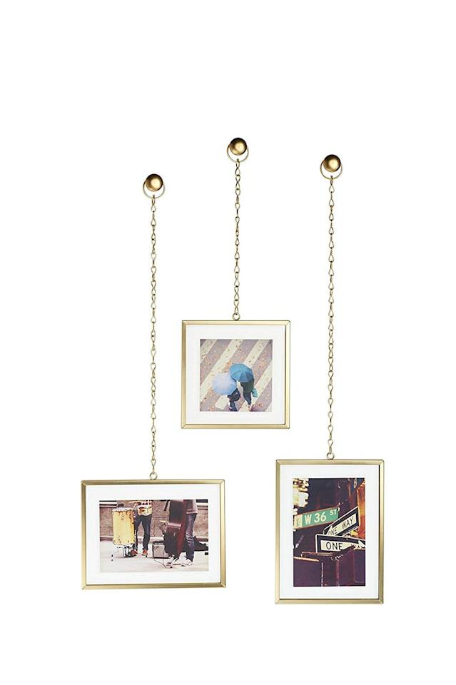 """<p><strong>Umbra Fotochain Photo Display Set of 3, <em>$22.99</em></strong></p><p><a class=""""body-btn-link"""" href=""""https://www.amazon.com/Umbra-Fotochain-Picture-Frames-Nickel/dp/B01M5CWJPK?tag=syn-yahoo-20&ascsubtag=%5Bartid%7C10057.g.28425217%5Bsrc%7Cyahoo-us"""" target=""""_blank"""">BUY NOW</a></p><p>Since Amazon has millions of items to offer, you can find just about any style and brand of picture frame imaginable at various price points. Simple and straightforward or unique and decorative, you're bound to find something you like.</p><p><strong>Shop more frames at <a href=""""https://www.amazon.com/picture-frames/b/ref=dp_bc_aui_C_3?ie=UTF8&node=1063286"""" target=""""_blank"""">Amazon.com</a>.</strong></p>"""