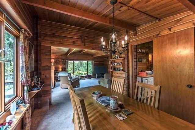 <p><span>15450 27A Avenue, Surrey, B.C.</span><br> The Pan Abode home feels like a cabin, with its wood panelling throughout.<br> (Photo: Zoocasa) </p>