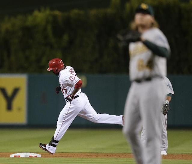 Los Angeles Angels' Howie Kendrick, left, round the bases after a home run off Oakland Athletics starting pitcher A.J. Griffin during the first inning of a baseball game in Anaheim, Calif., Tuesday, Sept. 24, 2013. (AP Photo/Chris Carlson)