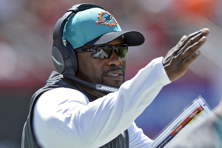 Miami Dolphins head coach Brian Flores calls a play against the Tampa Bay Buccaneers during the first half of an NFL football game Sunday, Oct. 10, 2021, in Tampa, Fla. (AP Photo/Jason Behnken)