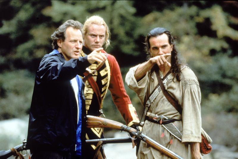American filsm director Michael Mann (left) points into the distance as he rehearses a scene with British actors Steven Waddington (center) and Daniel Day-Lewis during the filming of 'Last of the Mohicans,' North Carolina, 1992. (Photo by Fotos International/Frank Connor/Getty Images)