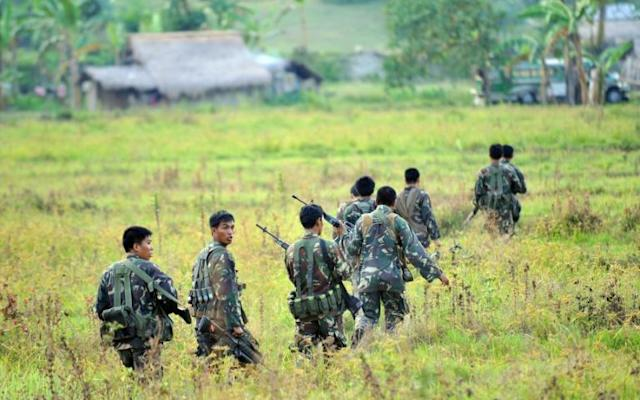 12 dead as Philippine troops battle militants in south