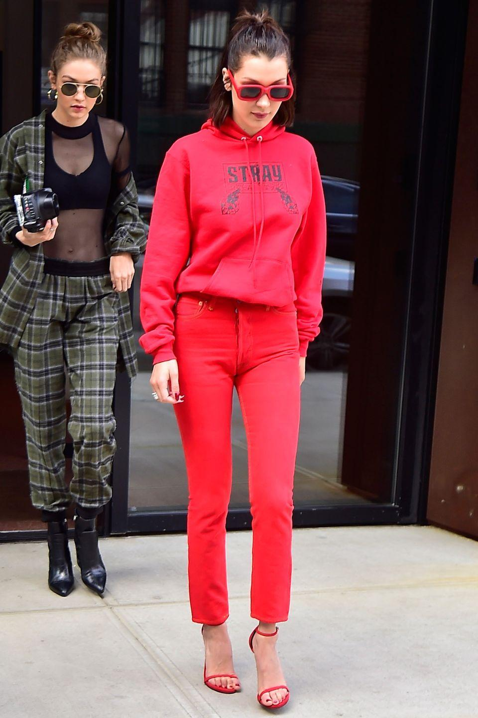 <p>In a red hoodie, jeans, heeled sandals and sunglasses while out in New York with sister Gigi Hadid.</p>