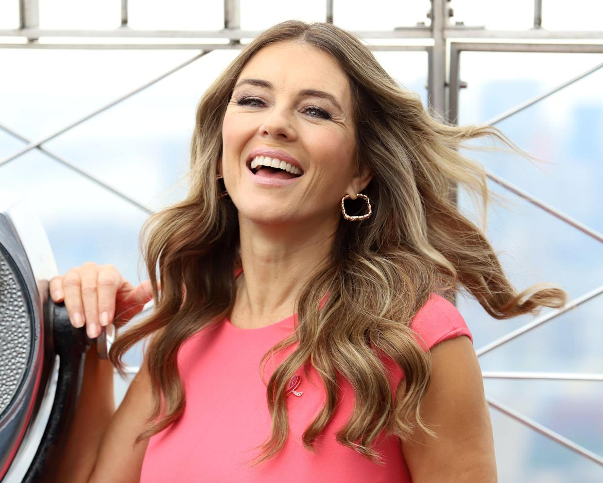 Elizabeth Hurley lights the Empire State Building on behalf of The Estee Lauder Companies' Breast Campaign in New York.
