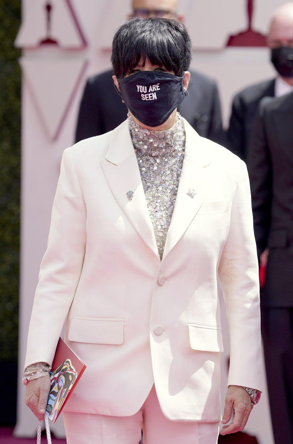 <p>The singer and songwriter teamed her Valentino white suit with a face mask emblazoned with the message 'You Are Seen', which refers to her song 'Io sì (Seen)', created for the 2020 film The Life Ahead.</p>