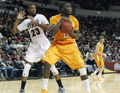 Tennessee center Yemi Makanjuola (0) looks down court for an open man after pulling down a first half rebound in front of Mississippi State forward Arnett Moultrie (23) during an NCAA college basketball game in Starkville, Miss., Thursday, Jan. 12, 2012. (AP Photo/Rogelio V. Solis)