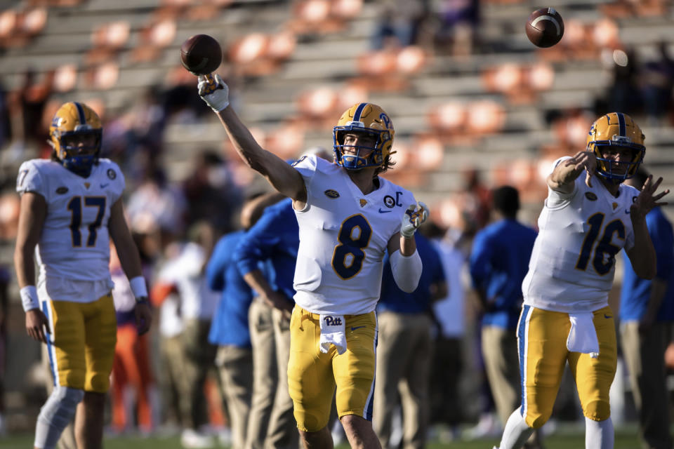 Pittsburgh quarterback Kenny Pickett (8) warms up with his team before an NCAA college football game against Clemson Saturday, Nov. 28, 2020, in Clemson, S.C. (Ken Ruinard/Pool Photo via AP)